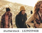 woman climbing a hill with...   Shutterstock . vector #1329059408