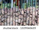 gabion from vertical metal rods ... | Shutterstock . vector #1329060635