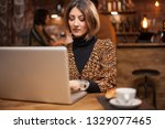 successful businesswoman typing ... | Shutterstock . vector #1329077465