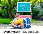 happy little kid boy with... | Shutterstock . vector #1329081608