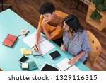 two young women studying in... | Shutterstock . vector #1329116315