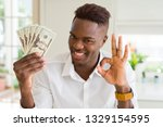 african american man holding... | Shutterstock . vector #1329154595