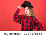 Small photo of Acting school for children. Acting lessons guide children through wide variety of genres. Develop talent into career. Girl artistic kid practicing acting skills with black hat. Enter acting academy.