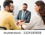 selective focus of investors...   Shutterstock . vector #1329185858