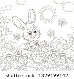 little bunny coloring a big... | Shutterstock .eps vector #1329199142