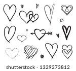 hand drawn grunge hearts on... | Shutterstock . vector #1329273812