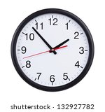 Round Office Clock Shows Five...