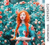Small photo of Young beautiful redhead girl with very long hair braided in plait on rose background. Fabulous renaissance woman in flower dress against the backdrop of a beautiful rose bush. Redhead doll with plait