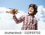 Boy In Helmet Pilot Playing...