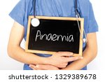 Small photo of Doctor shows information on blackboard: anaemia. Medical concept.