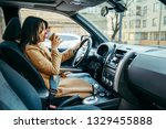 young pretty woman driving car...   Shutterstock . vector #1329455888