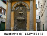 Small photo of Genoa / Italy - February 11 2018: The Infamous Column erected in 1628 in ignoble memory of the high treason of Giulio Vachero, sentenced to death, and the fountain erected by his heirs to hide it