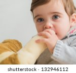 Cute Baby Holding With Toy, Indoors - stock photo