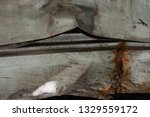 rusty rumpled car body is close | Shutterstock . vector #1329559172