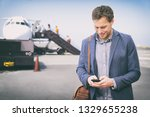 man texting on phone leaving... | Shutterstock . vector #1329655238