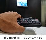 remote  control  on  the  ... | Shutterstock . vector #1329674468