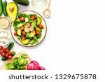 preparing fresh salad.... | Shutterstock . vector #1329675878