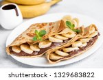 crepes stuffed with chocolate... | Shutterstock . vector #1329683822