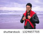 young indian man walking on the ... | Shutterstock . vector #1329857705