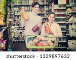 smiling female shopper with... | Shutterstock . vector #1329897632