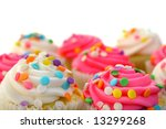 pink and white cupcakes with sprinkles - stock photo