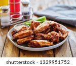 plate of bbq chicken wings with ... | Shutterstock . vector #1329951752