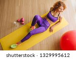 woman fitness trainer lying on... | Shutterstock . vector #1329995612