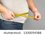a man measures his fat belly... | Shutterstock . vector #1330054388