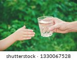 the father gives the child a... | Shutterstock . vector #1330067528