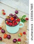 the child is picking cherries... | Shutterstock . vector #1330067885