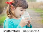 child glass of water. selective ... | Shutterstock . vector #1330100915