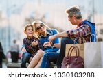 happy family enjoying shopping | Shutterstock . vector #1330103288