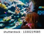 little girl watching fishes in... | Shutterstock . vector #1330219085