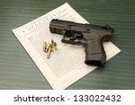 Pistol and Declaration. - stock photo