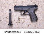 Handgun and bullets. - stock photo