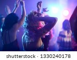 Stock photo beautiful young women dancing in night club 1330240178