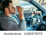 man driving car and drinking...   Shutterstock . vector #1330373975