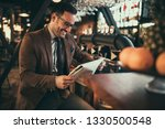 young businessman reading... | Shutterstock . vector #1330500548