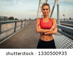an attractive young sportswoman ...   Shutterstock . vector #1330500935