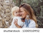 mom and baby portrait outdoors. ... | Shutterstock . vector #1330510952