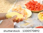 women are cutting ripe mangoes | Shutterstock . vector #1330570892