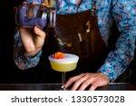 bartender garnishing a whisky...   Shutterstock . vector #1330573028