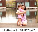 mother and daughter are... | Shutterstock . vector #1330625522