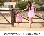 mother and daughter are... | Shutterstock . vector #1330625525