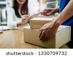 home delivery service man in... | Shutterstock . vector #1330709732