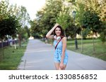 cheerful white woman in blue... | Shutterstock . vector #1330856852