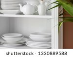 set of clean dishes on shelves... | Shutterstock . vector #1330889588