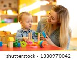 teacher or mother playing with...   Shutterstock . vector #1330970042