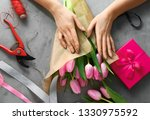 female florist making beautiful ... | Shutterstock . vector #1330975592