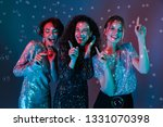 three cheerful beautiful women... | Shutterstock . vector #1331070398